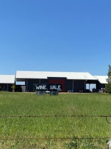 Shed At Michael Unwin Wines with Wine Sale sign in front
